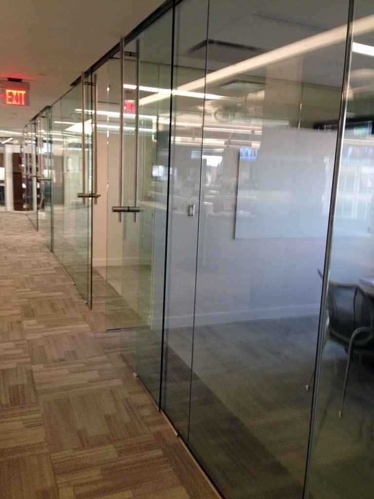 Image of locking ladder pulls installed on office glass doors