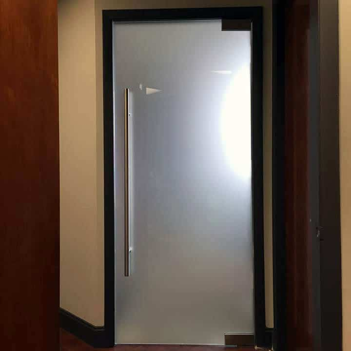 Image of locking ladder pull installed on corporate glass door